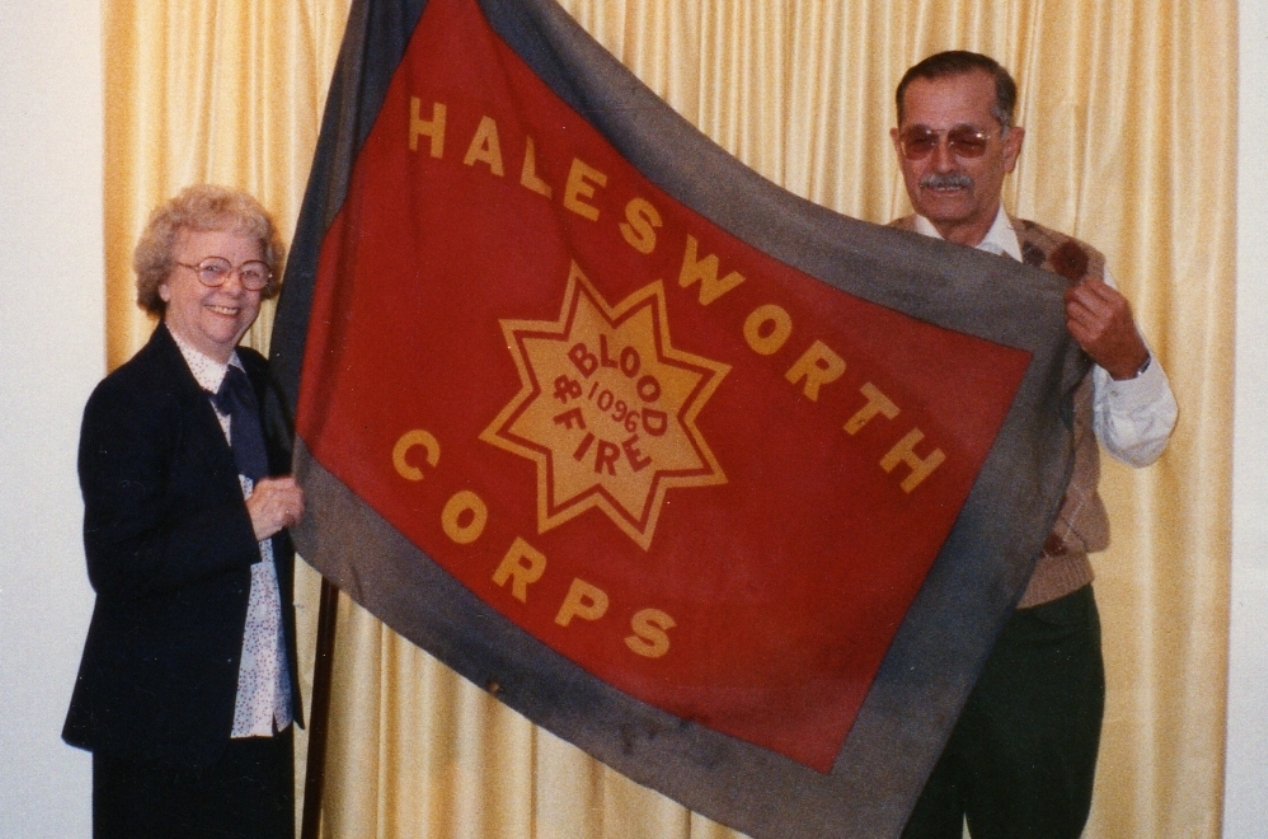 Gladys & Elmer with Halesworth flag - they met there in 1943 566